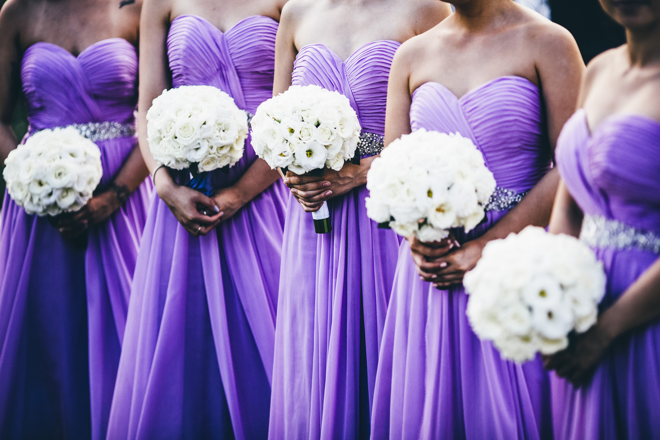 Bridesmaids at a wedding with completely identical dresses