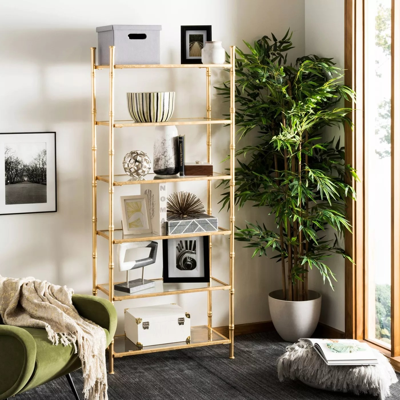 The gold and glass shelving unit