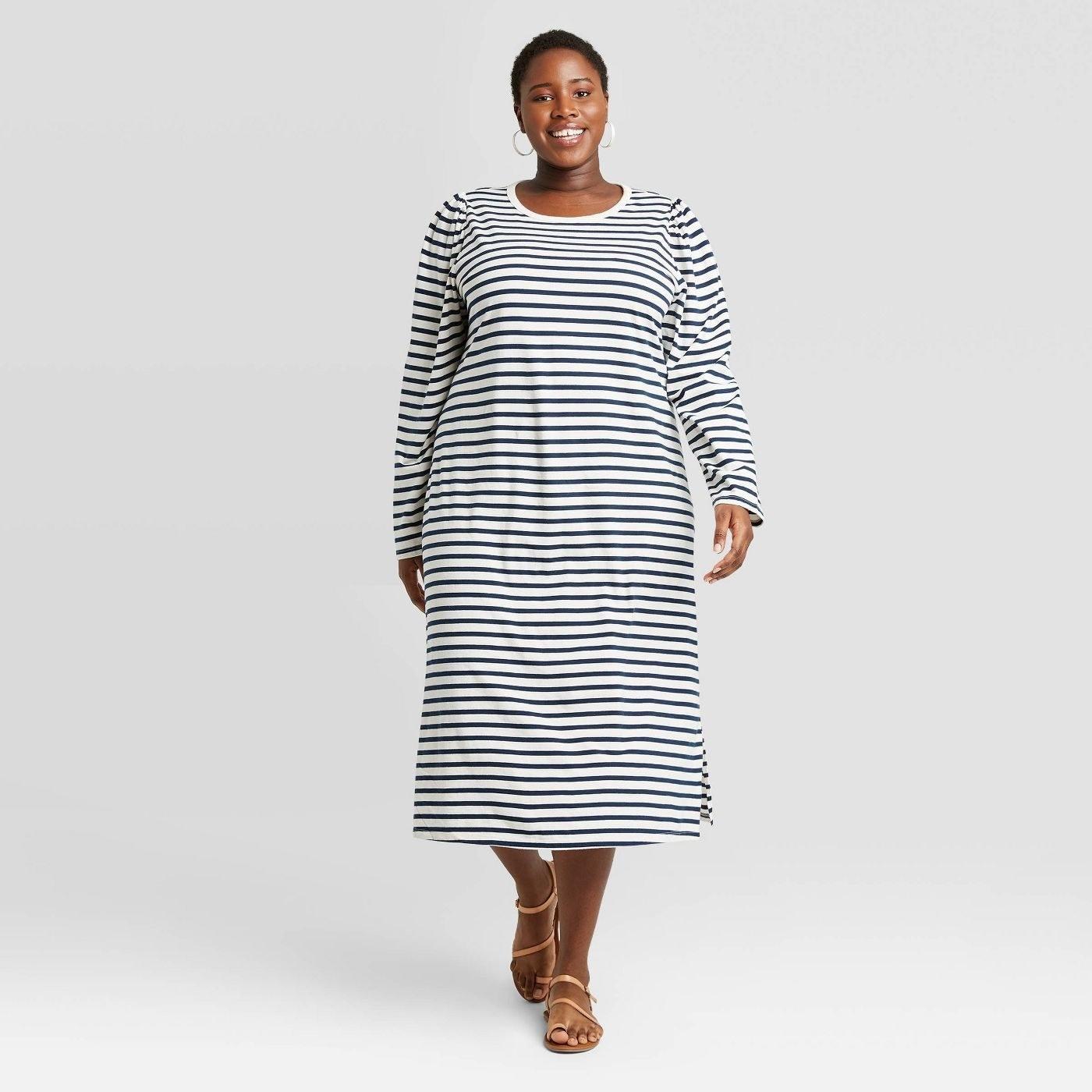Model wearing navy striped long sleeve maxi dress