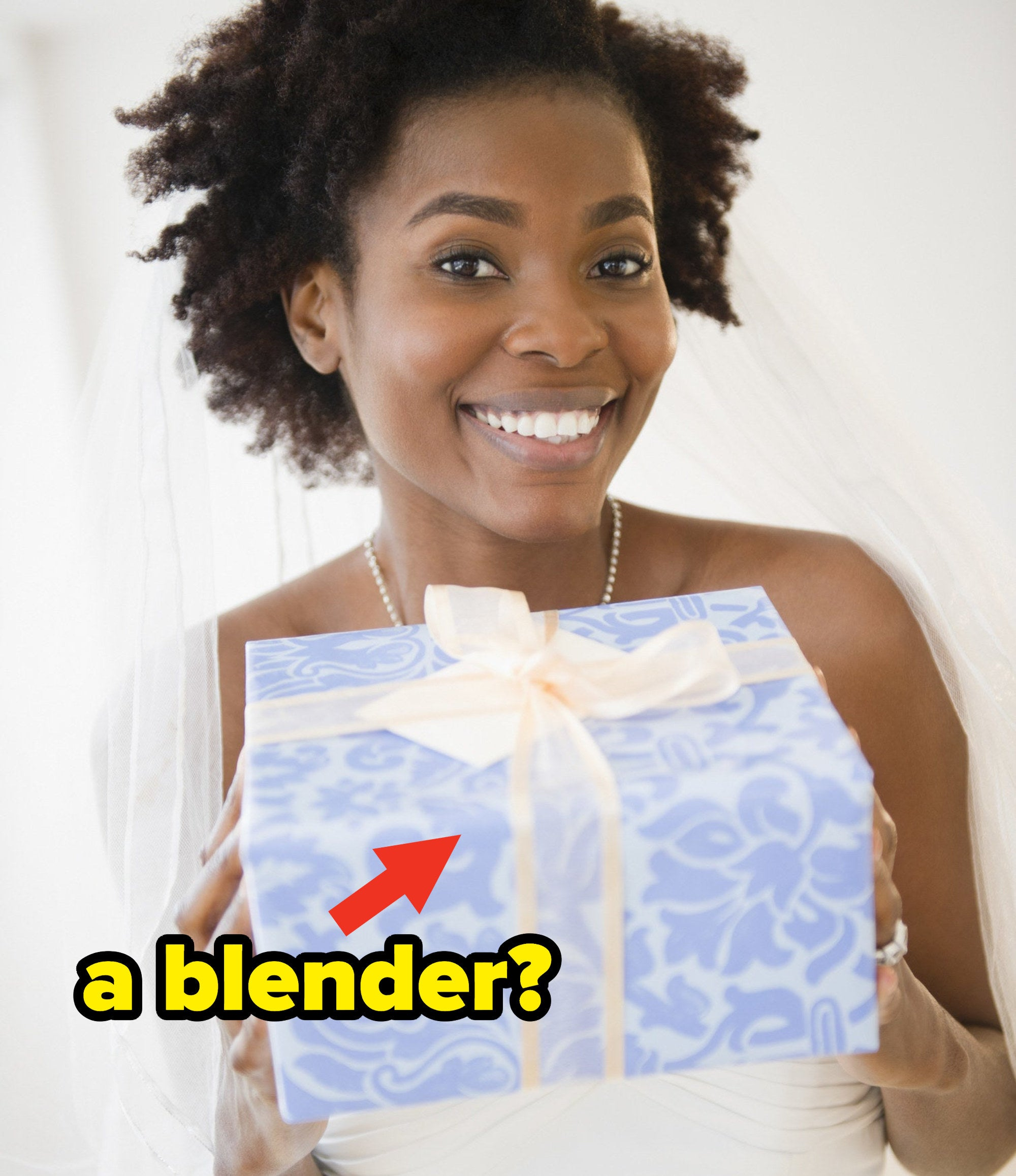 "A bride holding a wrapped wedding gift with a question caption: ""a blender?"""