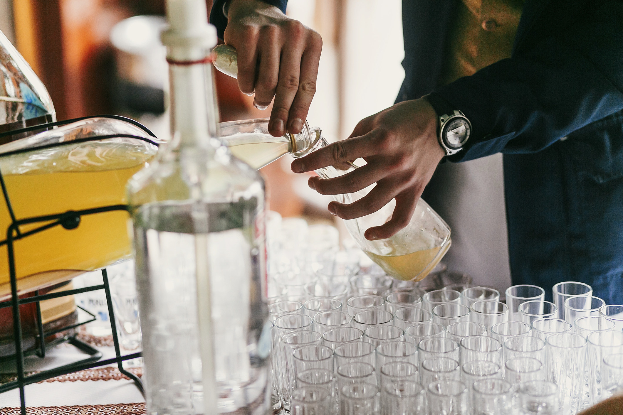 A waiter pouring a drink at a wedding party