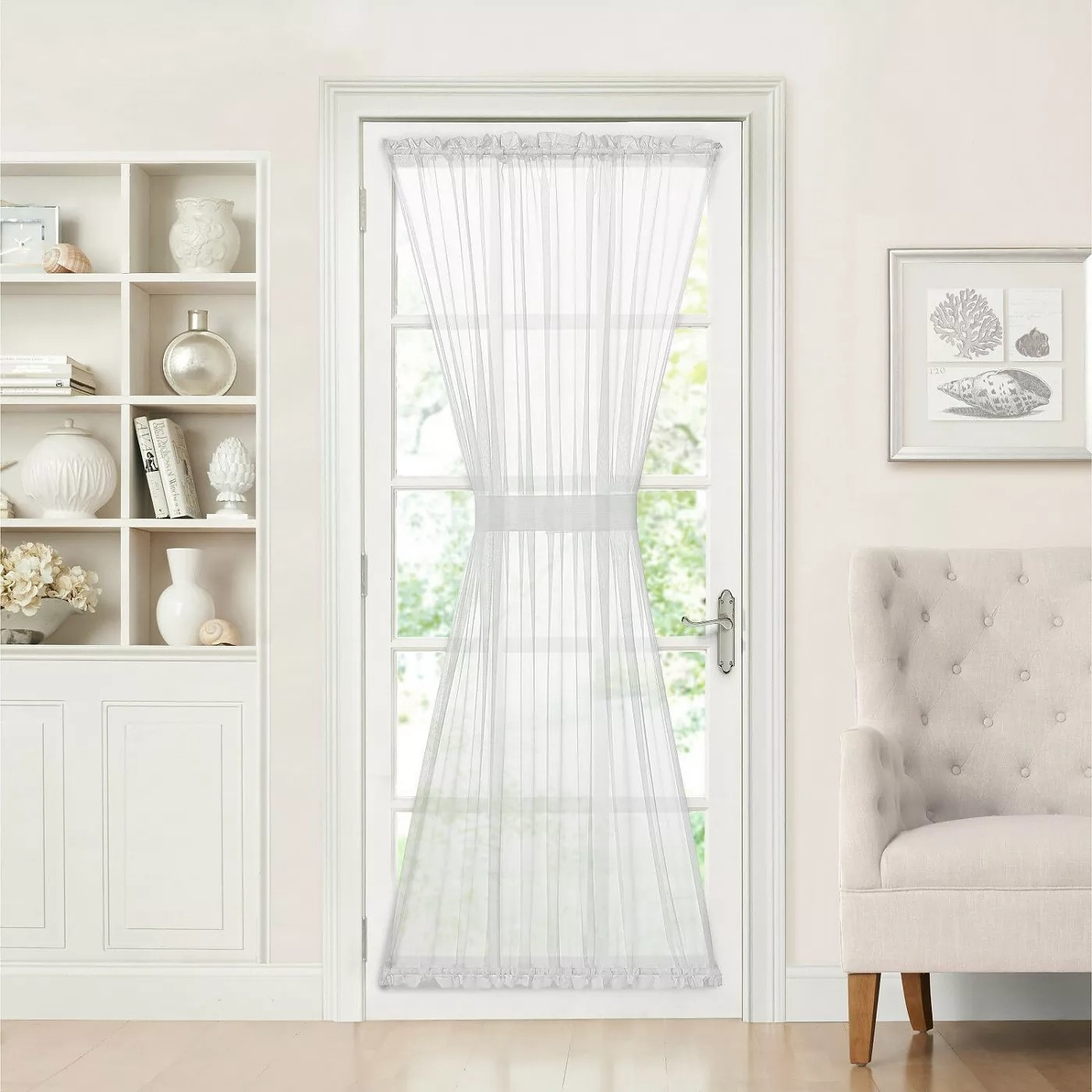The white curtain panel with a tie-back band