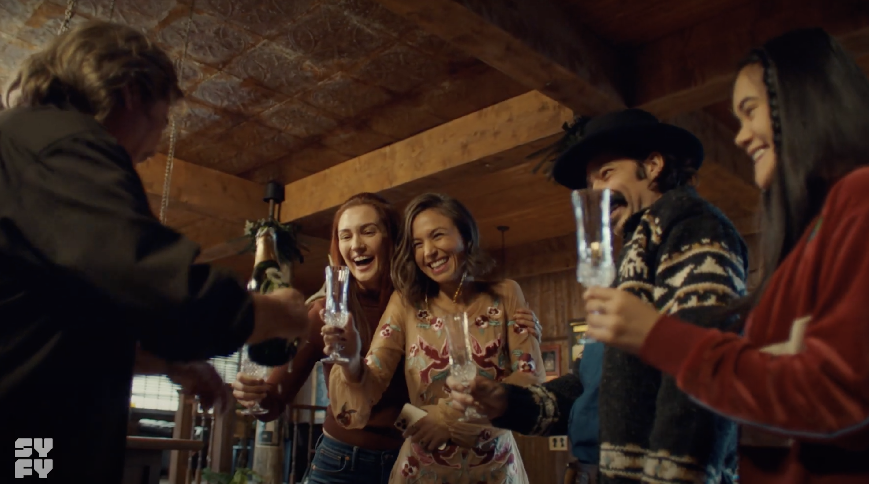 Nicole, Waverly, and others making a toast