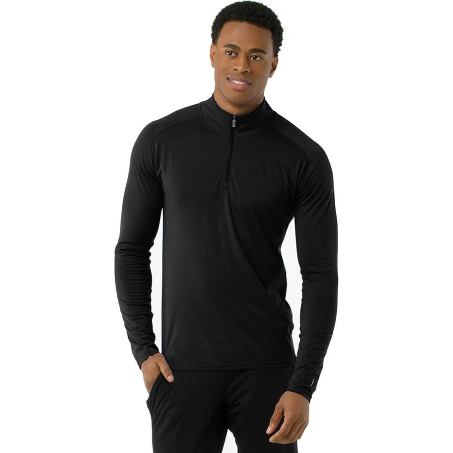 Model wearing the base layer in the color Black