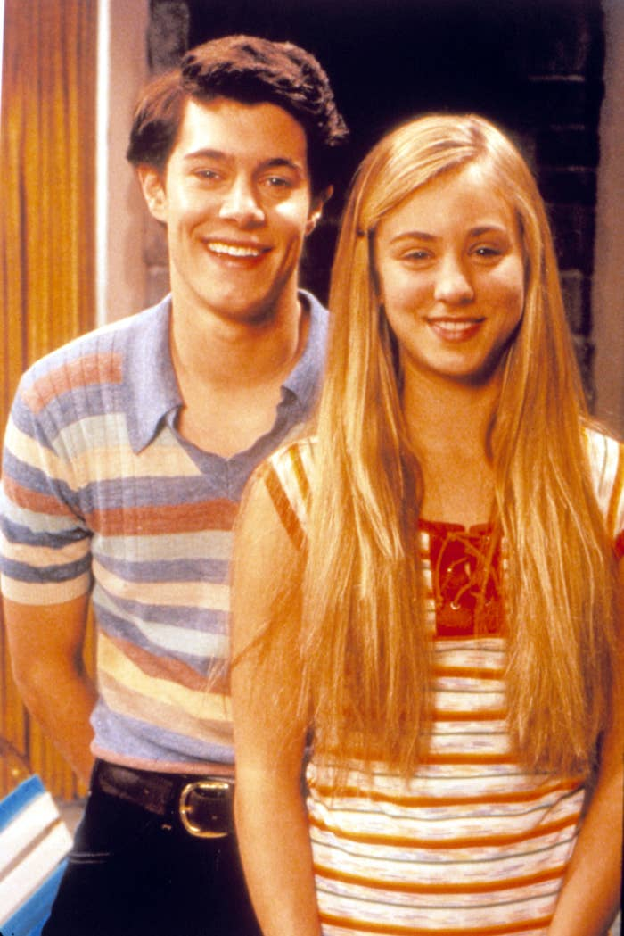 A photo of Adam Brody and Kaley Cuoco dressed up as Greg and Marcia Brady