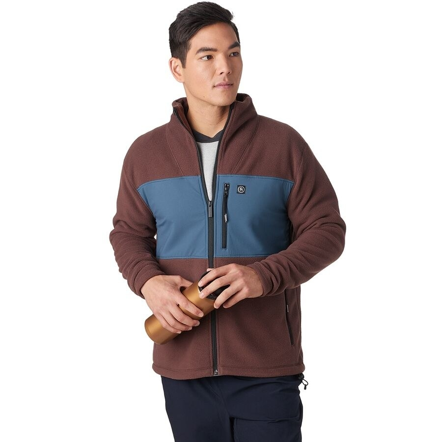Model wearing the fleece in the color French Roast/Orion Blue