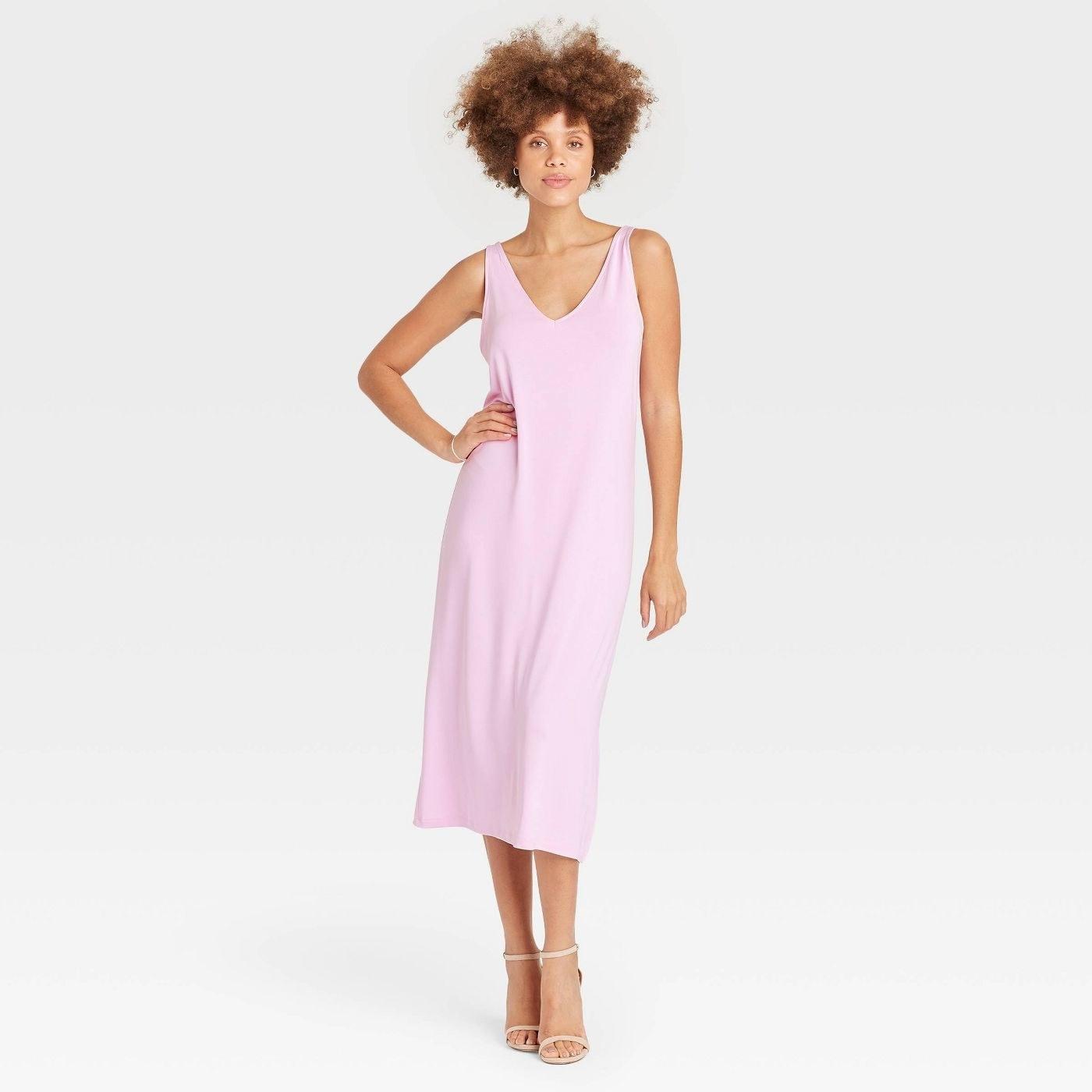 Model wearing light pink tank dress