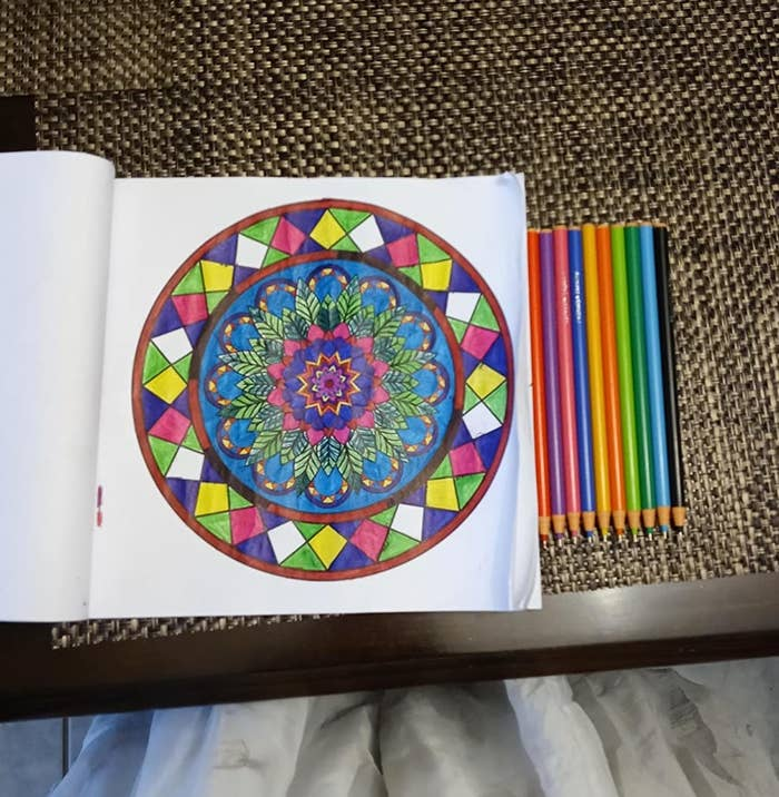 reviewer photo showing a page from coloring book colored in