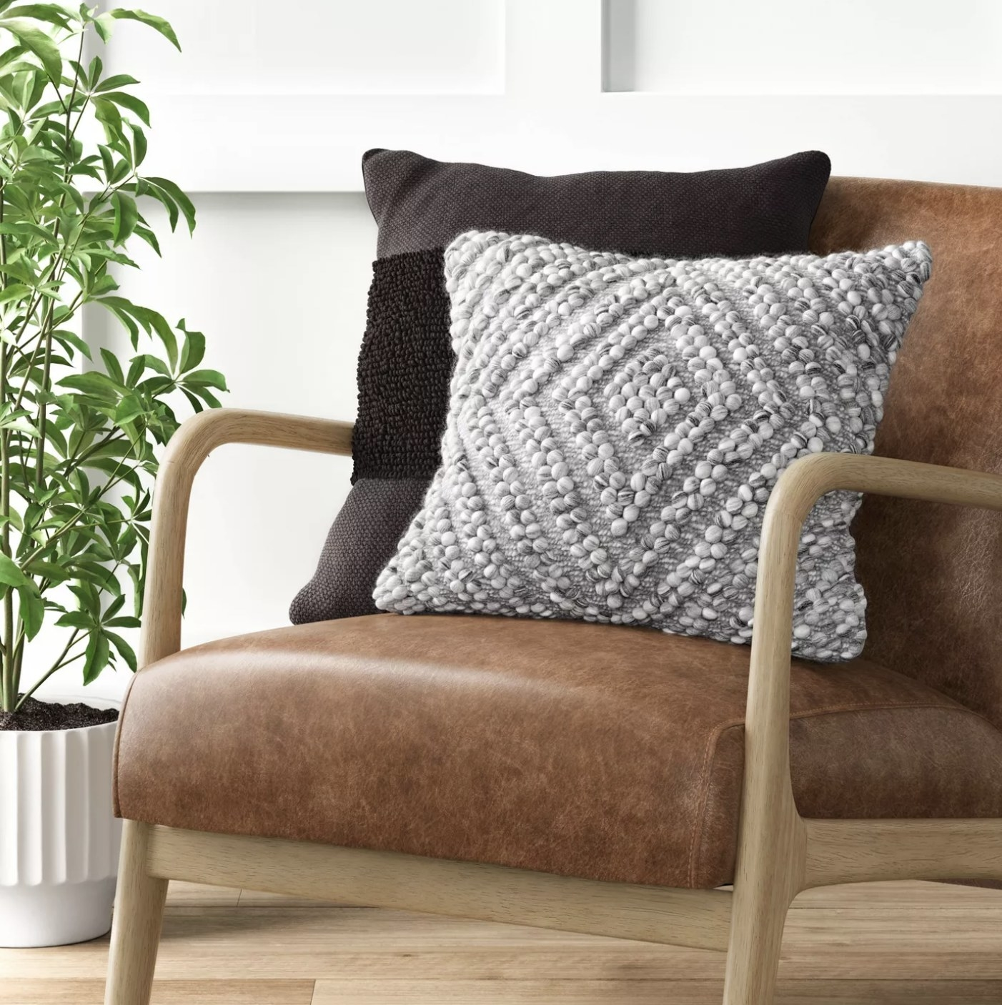 Diamond patterned throw pillow on a chair