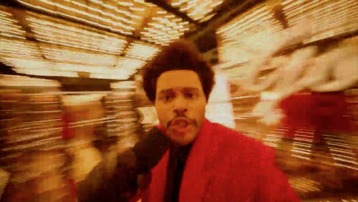 The Weeknd wandering through a maze full of lights and getting extremely close to the camera