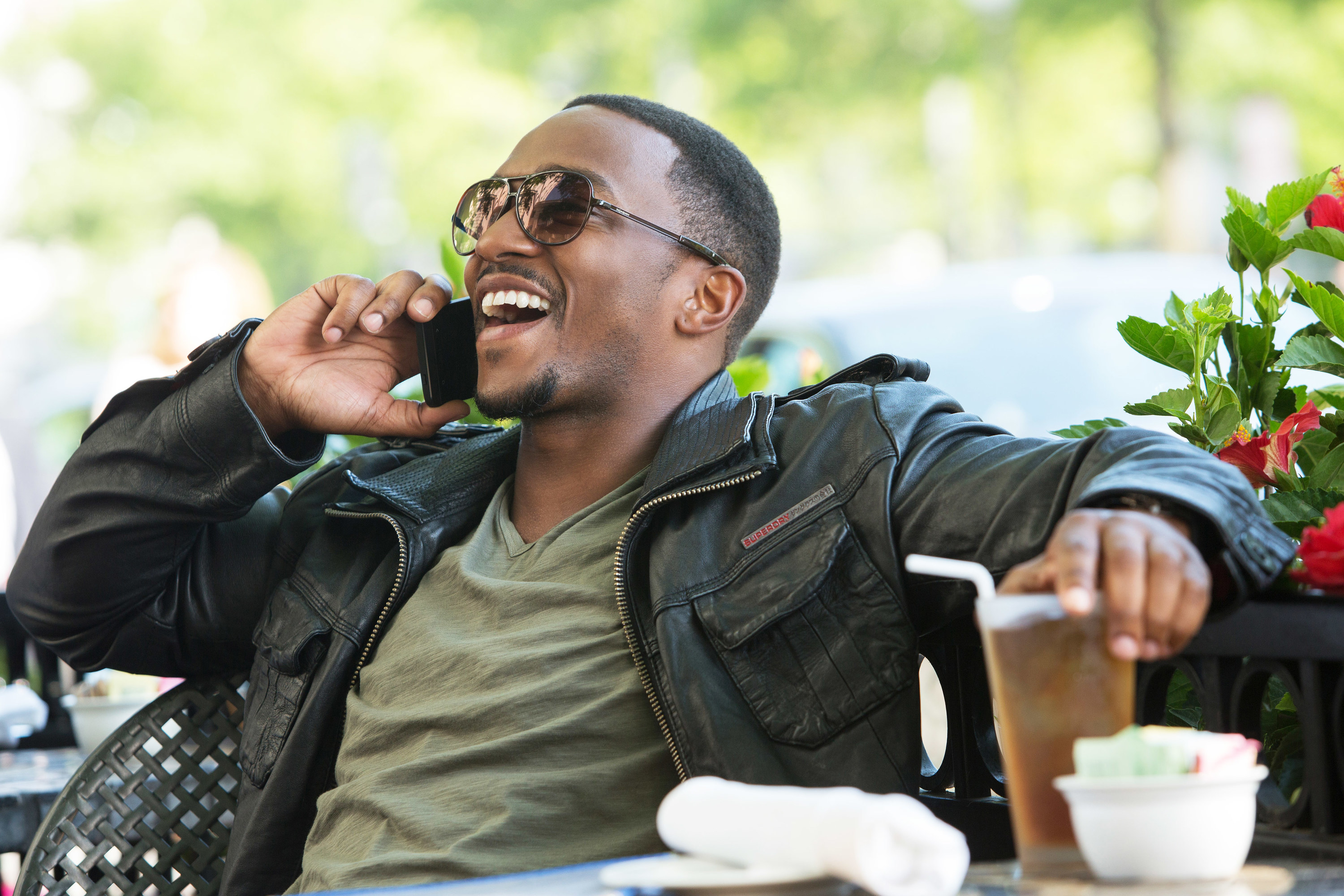 Anthony Mackie laughs while on the phone in Captain America: The Winter Soldier
