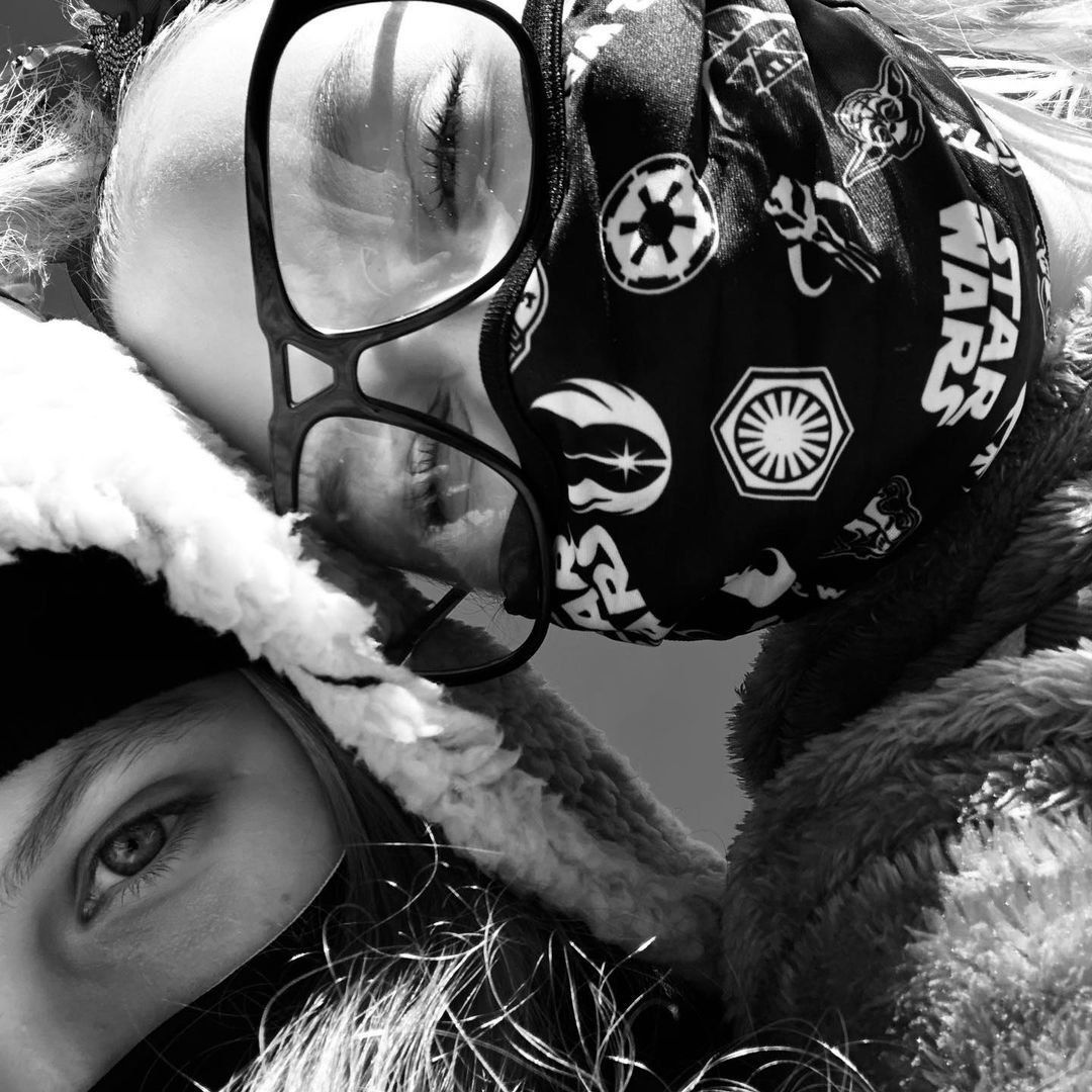 A closeup of JoJo and Kylie wearing face masks
