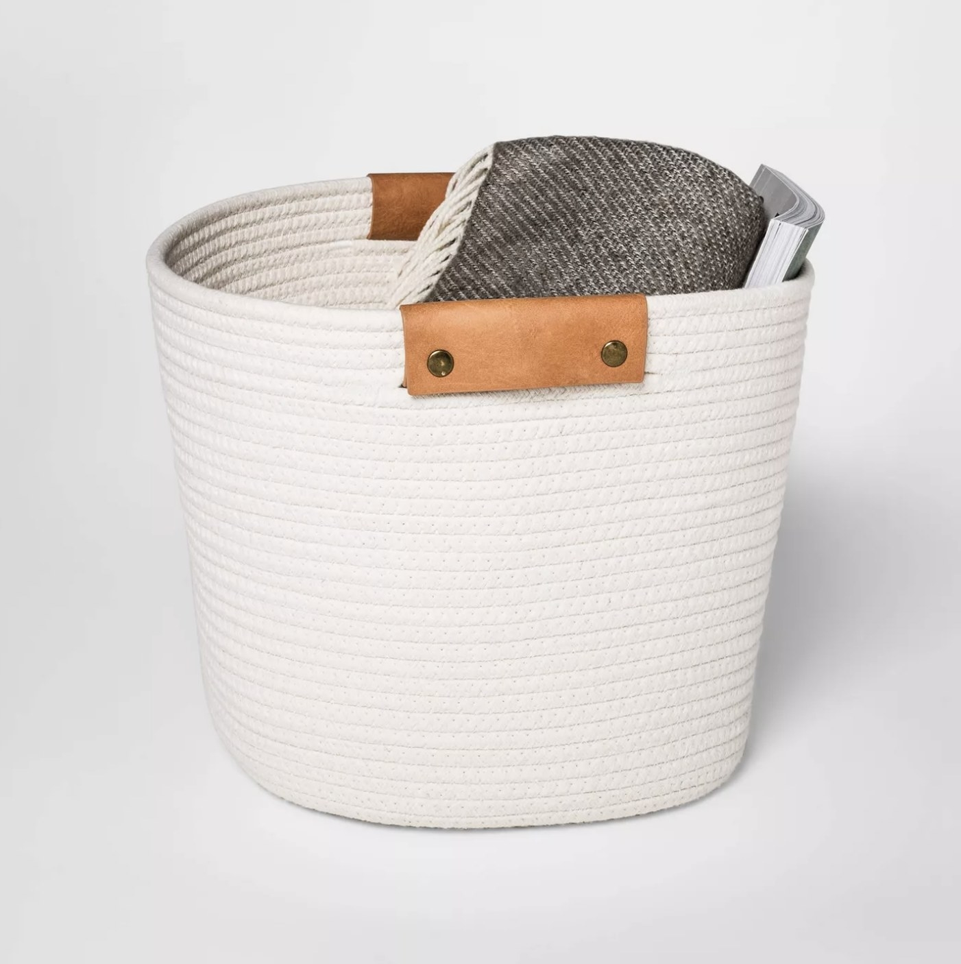A white coiled rope basket
