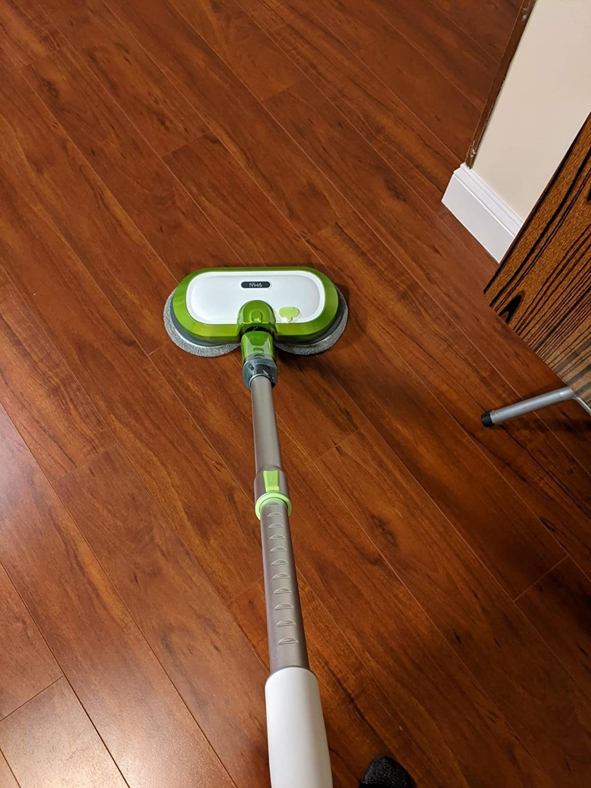 reviewer image of the vmai cordless electric mop cleaning hardwood floors