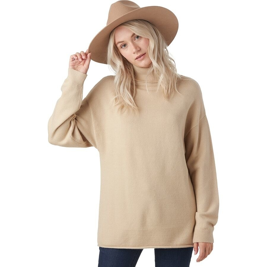 Model wearing the sweater in the color Oatmeal