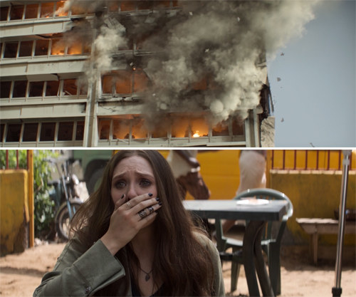 The building on fire and Wanda covering her mouth in shock and horror