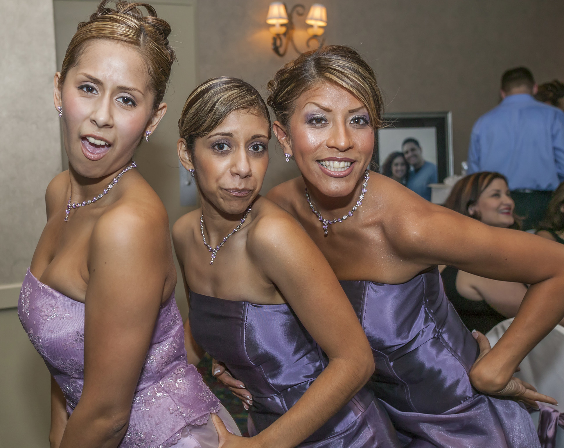 A trio of bridesmaids with matching dresses
