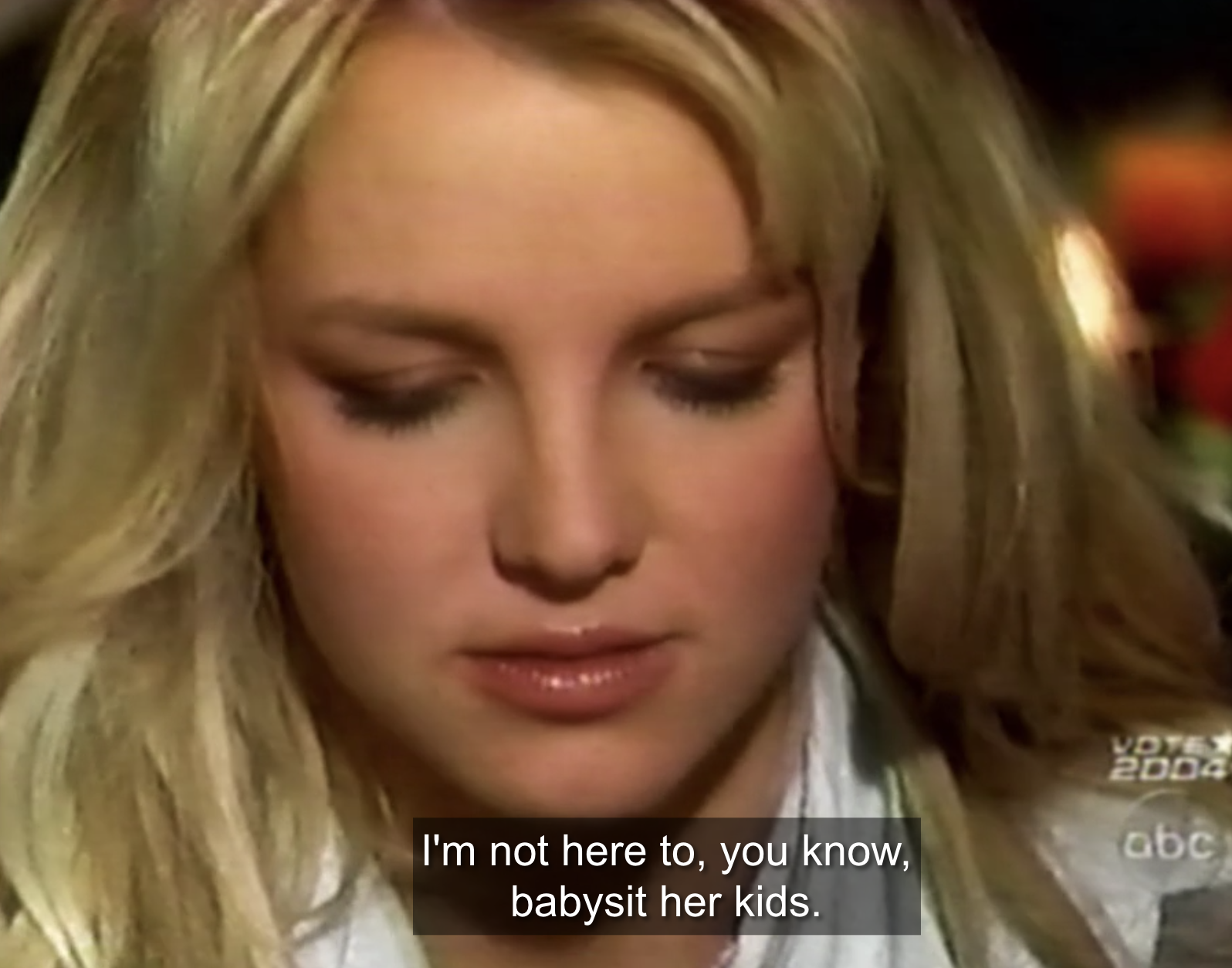 """Britney looking towards the floor, saying, """"I'm not here to, you know, babysit her kids"""""""