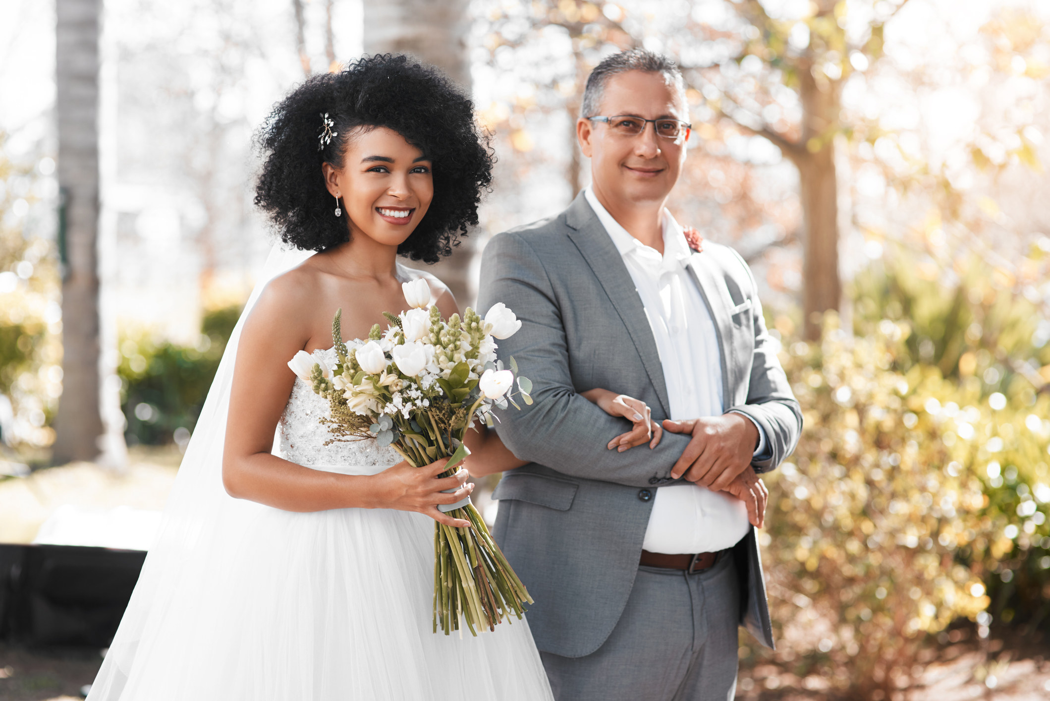 A bride and father walk down the aisle