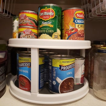 A reviewer's photo of the lazy Susan holding soup cans