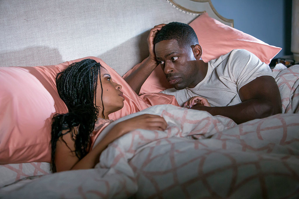 Still from This Is Us: Beth and Randall in their bed