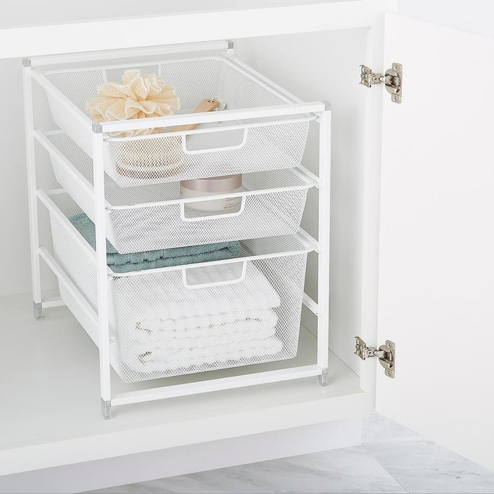 three white mesh drawer unit that can fit under a counter
