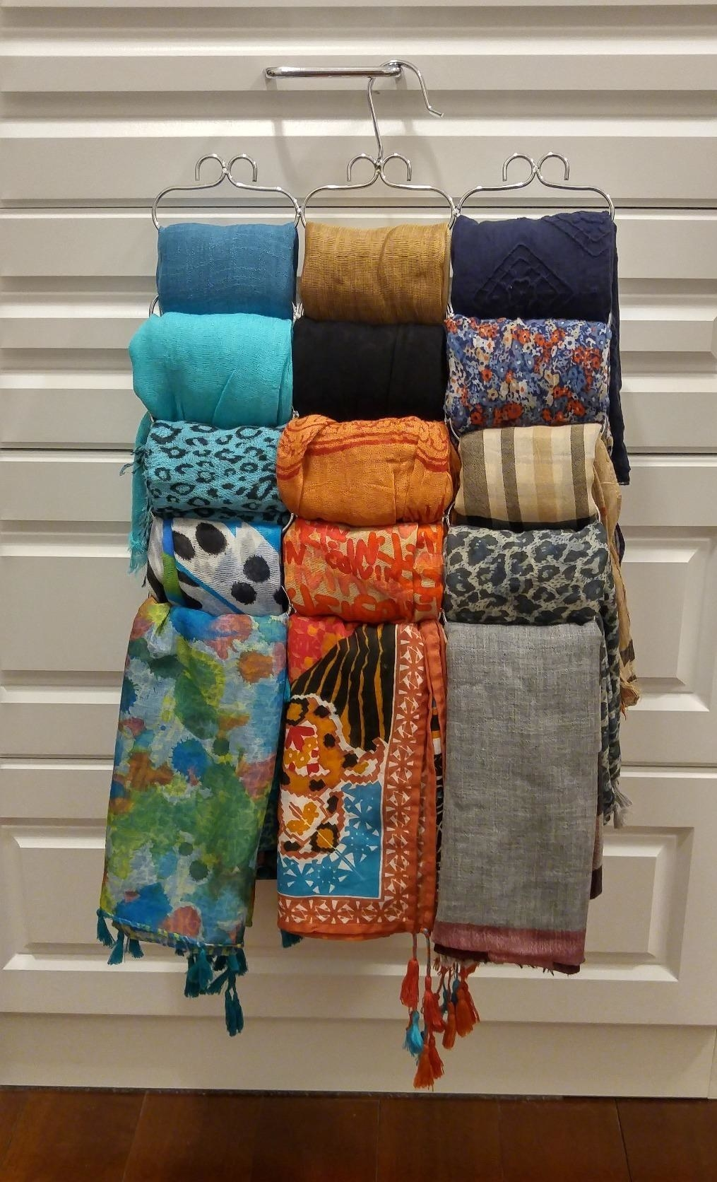 A reviewer's photo of the organizer holding 15 scarves