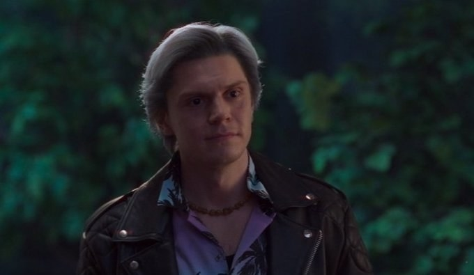 Evan Peters wearing a leather jacket and tropical-print shirt in WandaVision