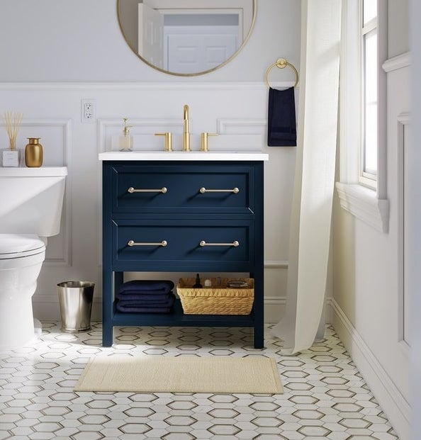 two-drawer navy vanity with white top