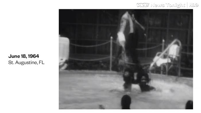 A screenshot of the video, showing swimming pool protesters at the Monson Motor Lodge in St. Augustine, Florida scream as motel manager James Brock dumps chemicals into the pool