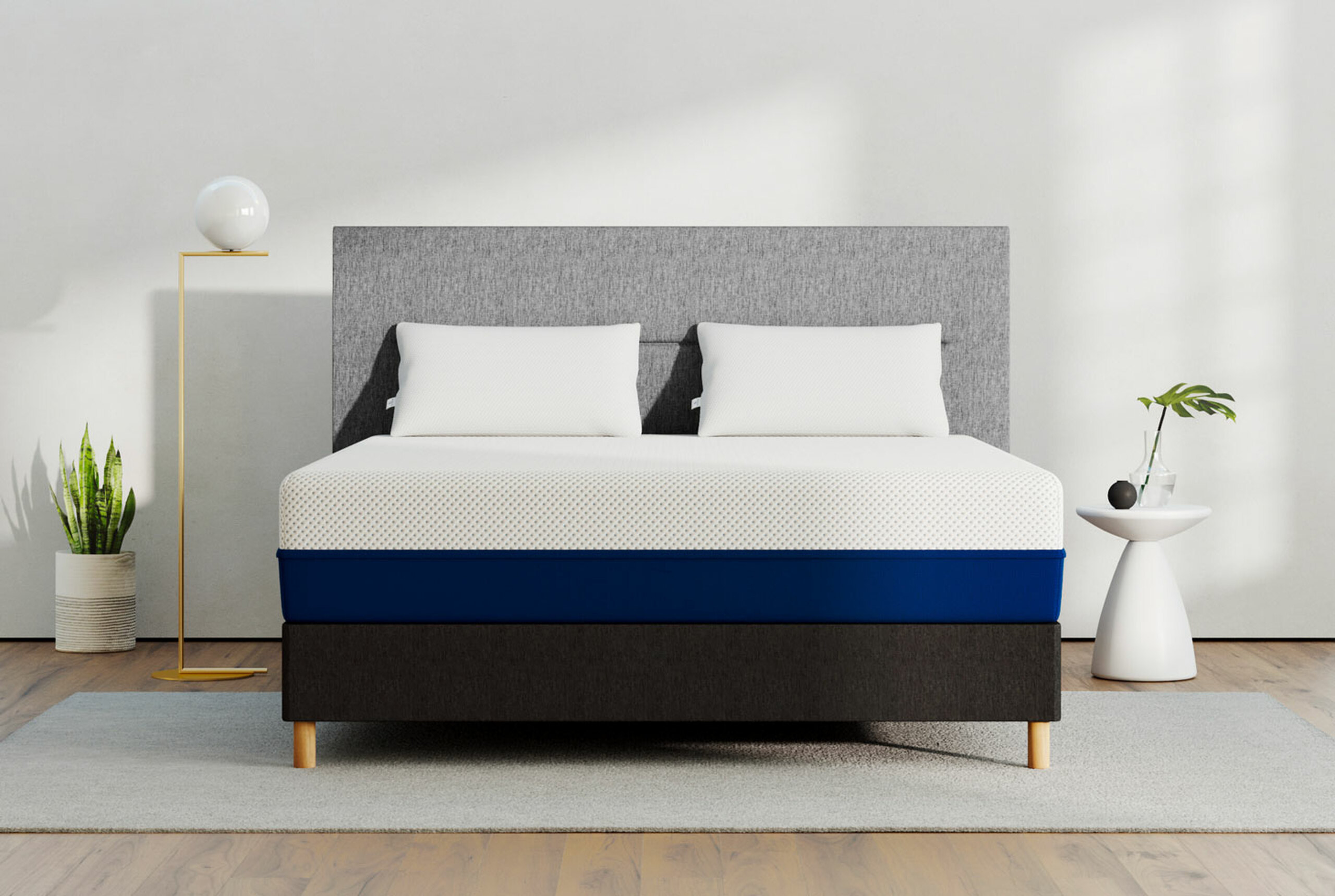 the mattress with white on top half and dark blue on the bottom half