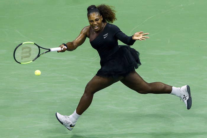 Serena Williams wearing a black tutu while competing at a Grand Slam