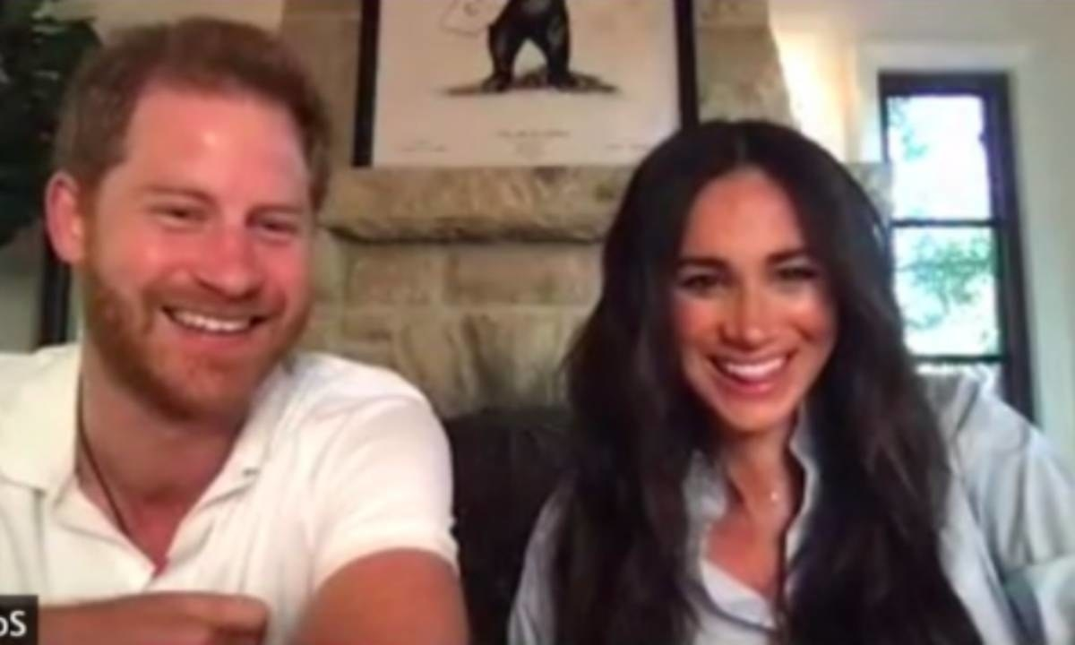 Meghan and Harry smile during the Zoom