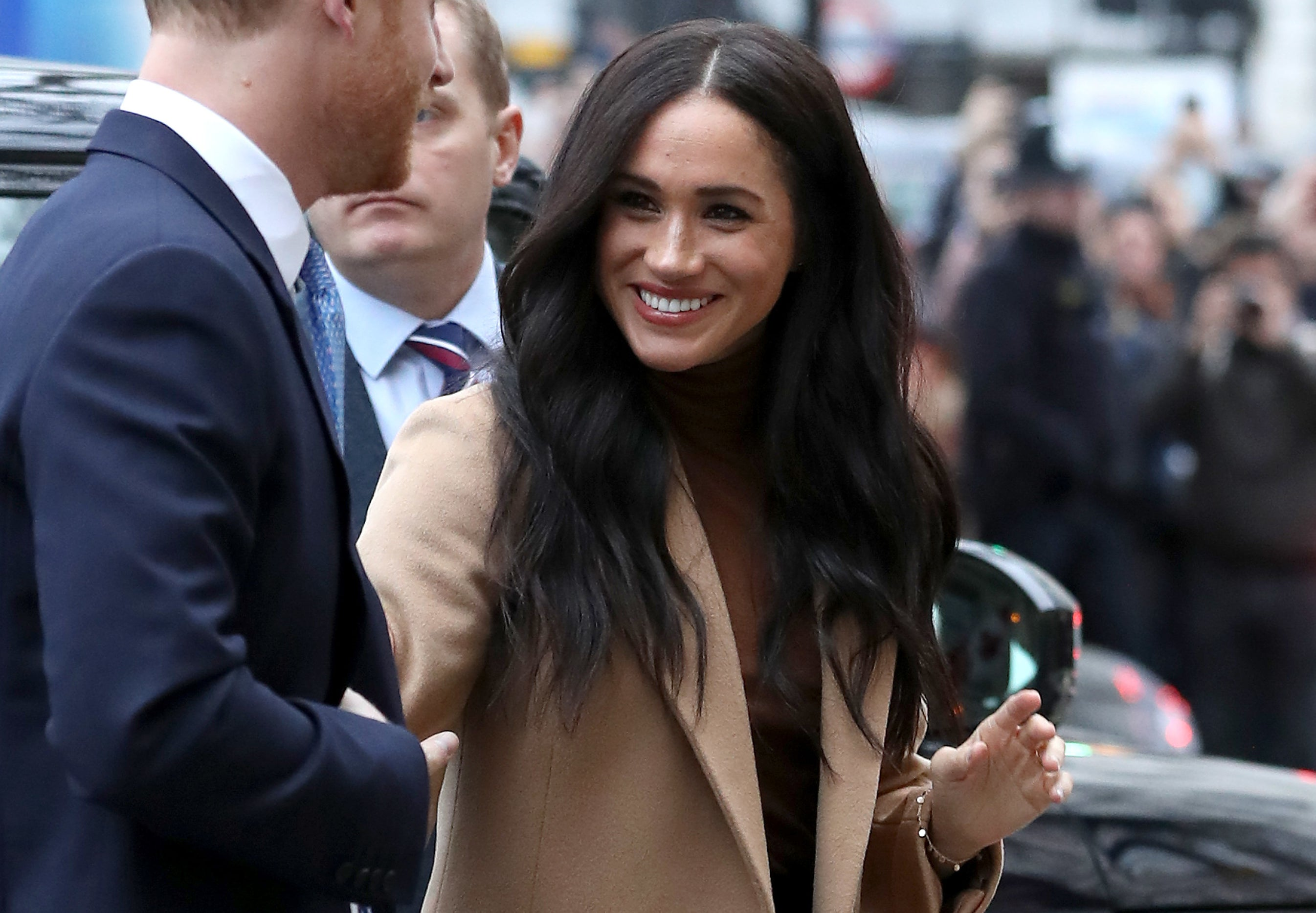 Meghan smiles on her way to an event
