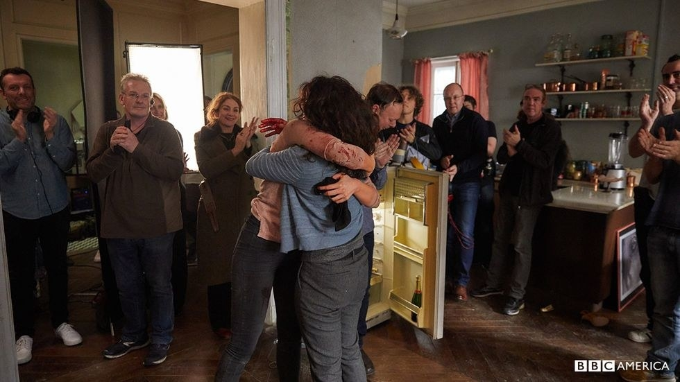 Sandra Oh and Jodie Comer hudding on set
