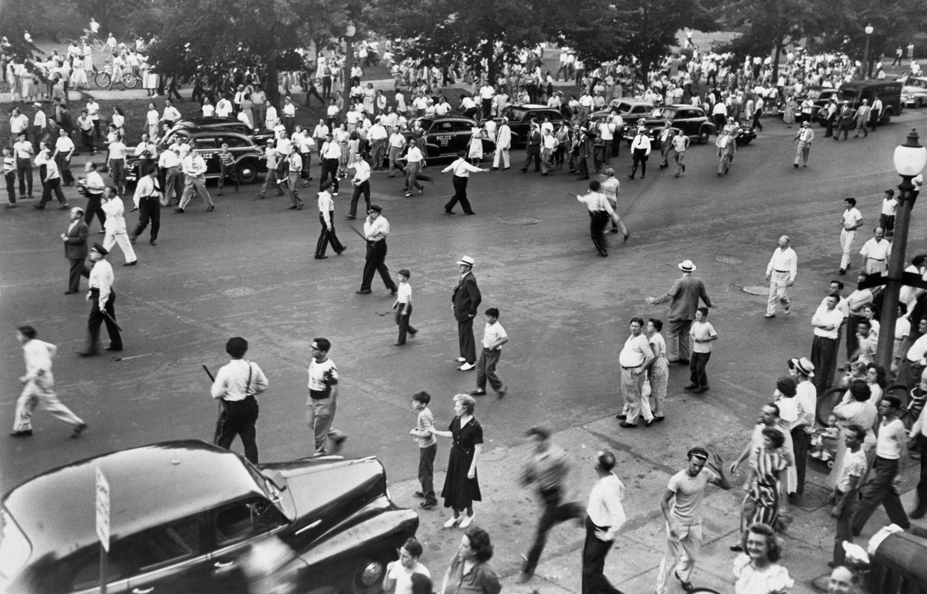 Police armed with nightsticks disperse part of a crowd of 5,000 persons during a race riot in St. Louis, June 21st
