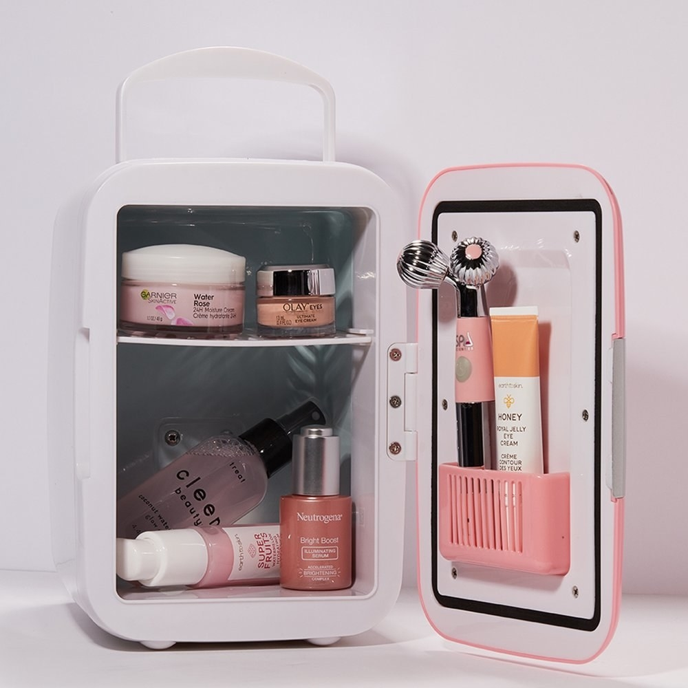 the fridge in pink with skincare inside