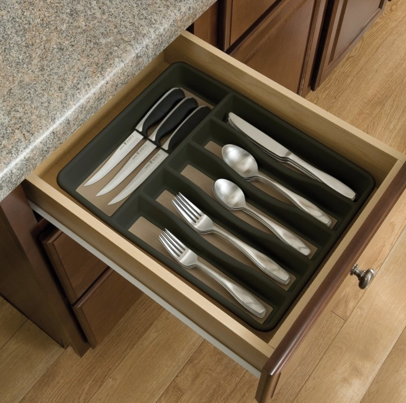 the organizer in a draw with cutlery inside of it