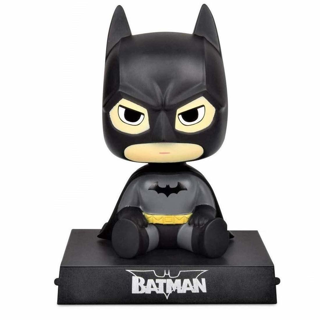 A Batman bobble head phone holder
