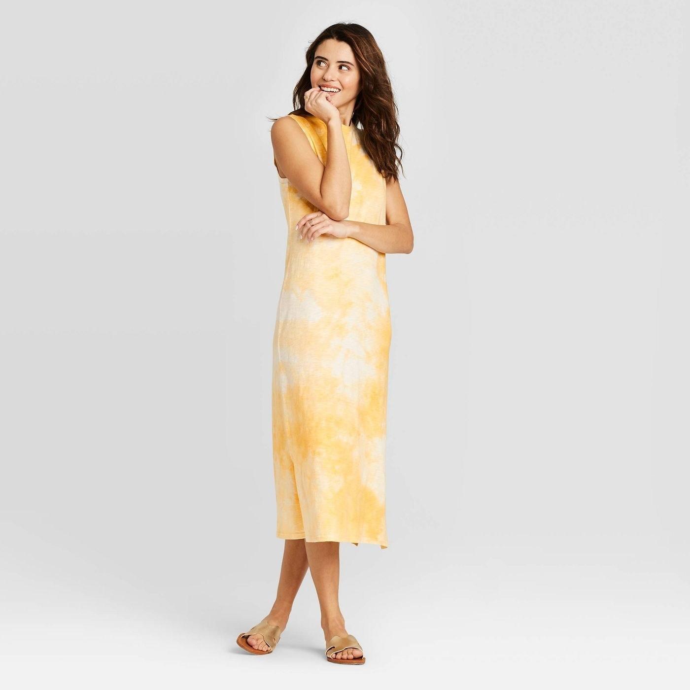 Model wearing yellow tie-dye dress