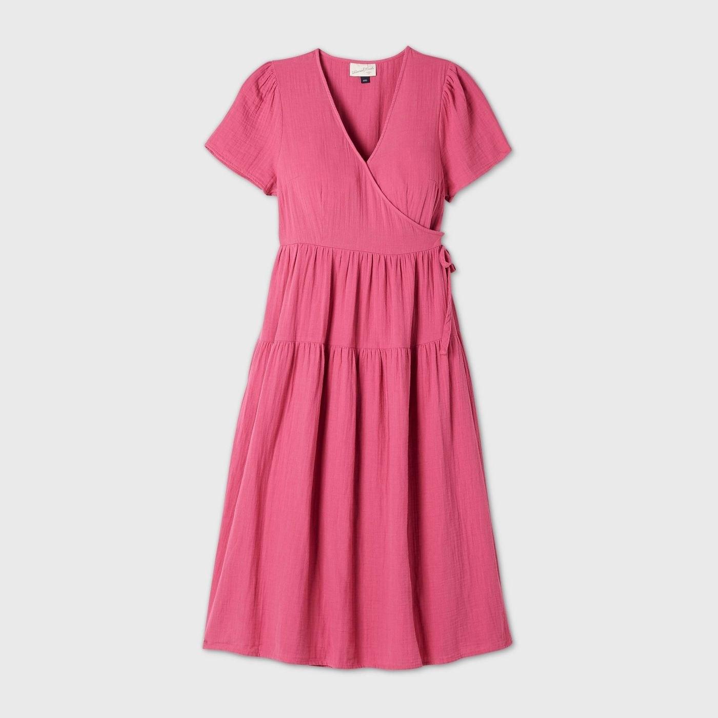 A pink wraparound dress