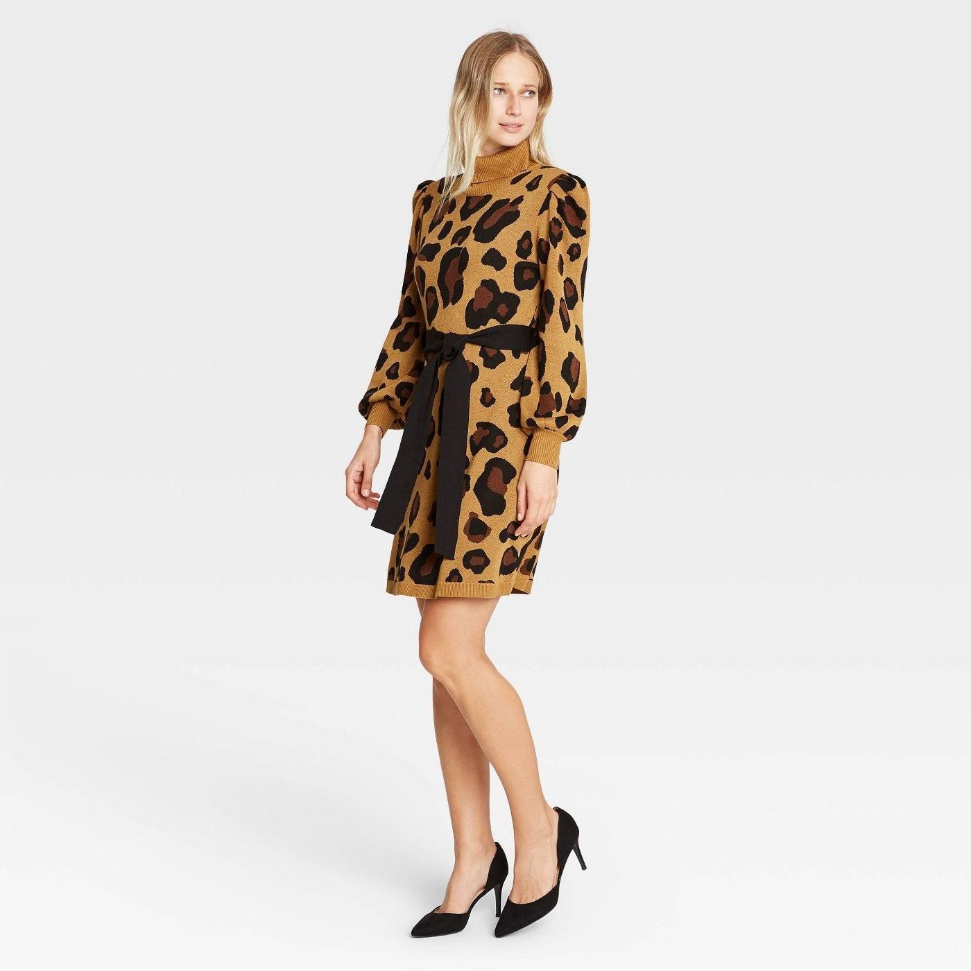 Model wearing leopard mini dress
