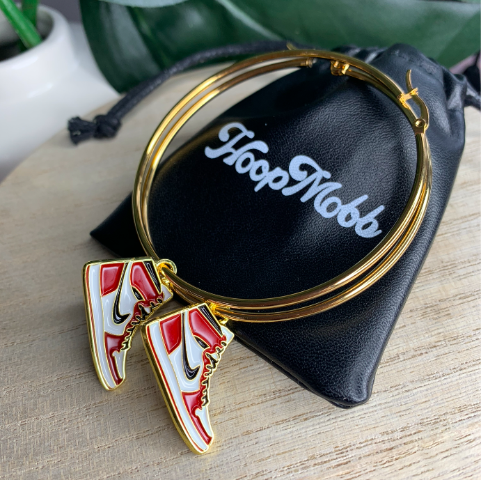 The large hoops with charms that look like red and white Nike high-tops