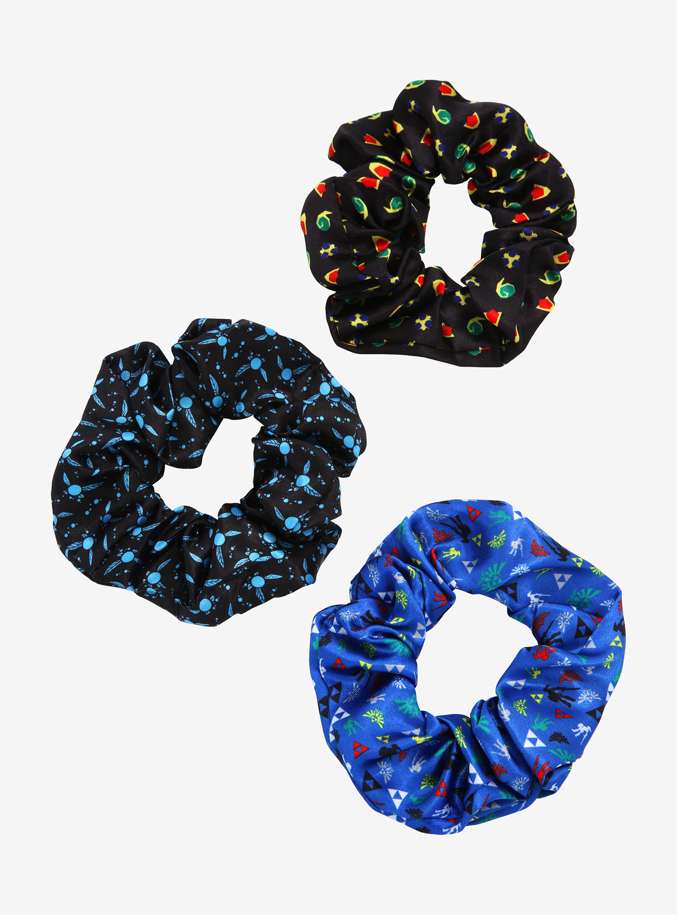 three scrunchies with zelda icon patterns on it