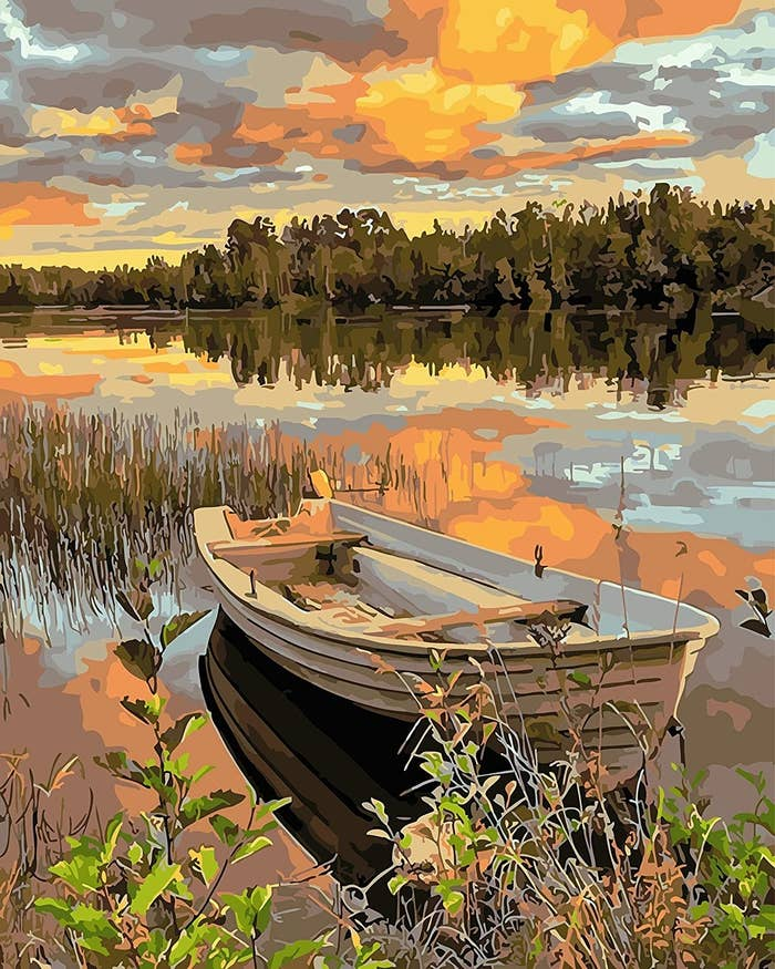 The paint by numbers finished product of a canoe sitting in a serene lake