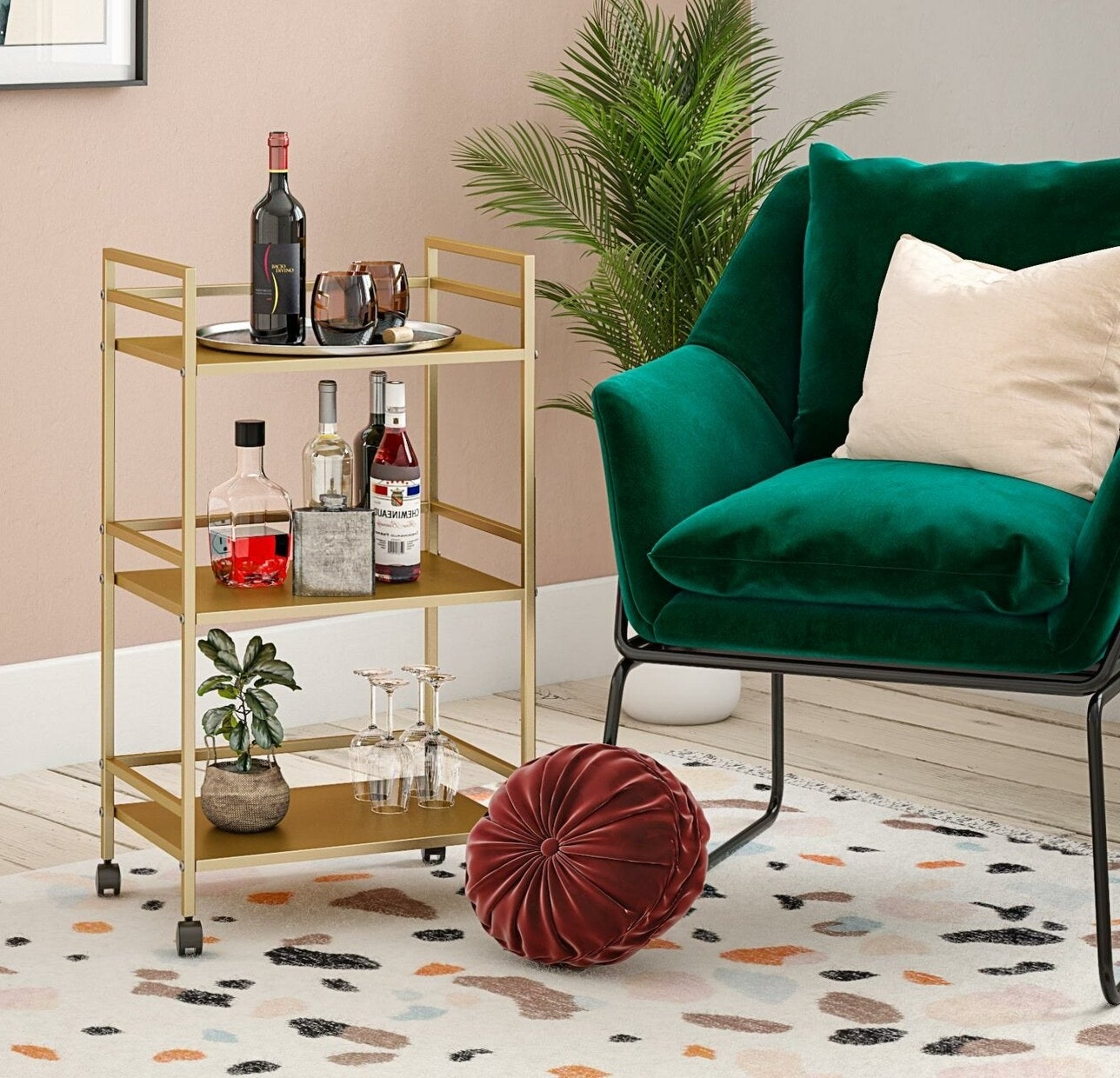 gold bar cart with wheels on the bottom