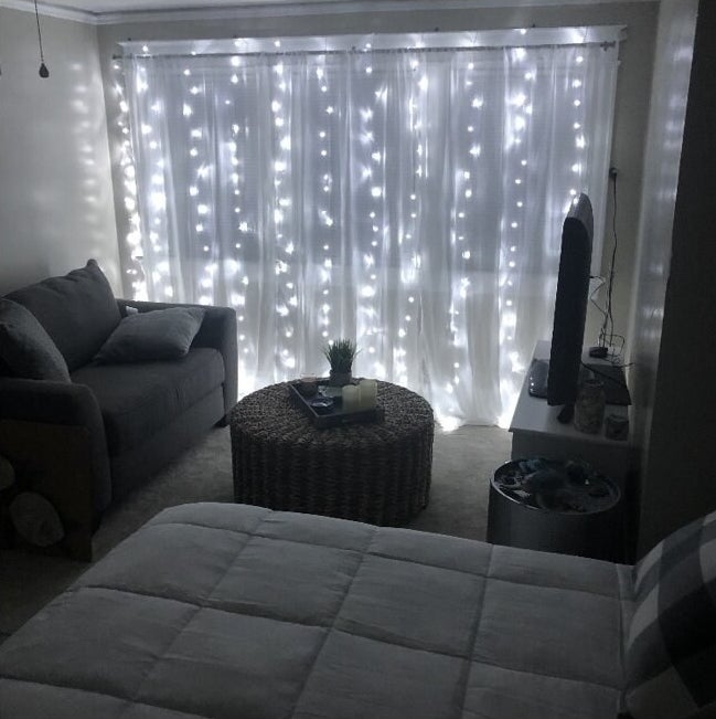 white string light curtain in a bedroom
