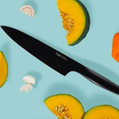 Knife beside slices of fruit