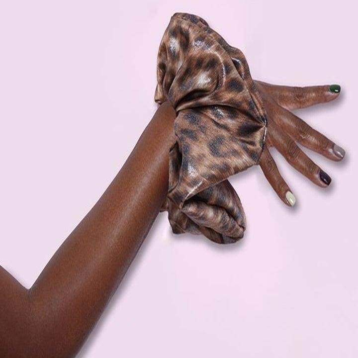 Model wearing scrunchie on hand