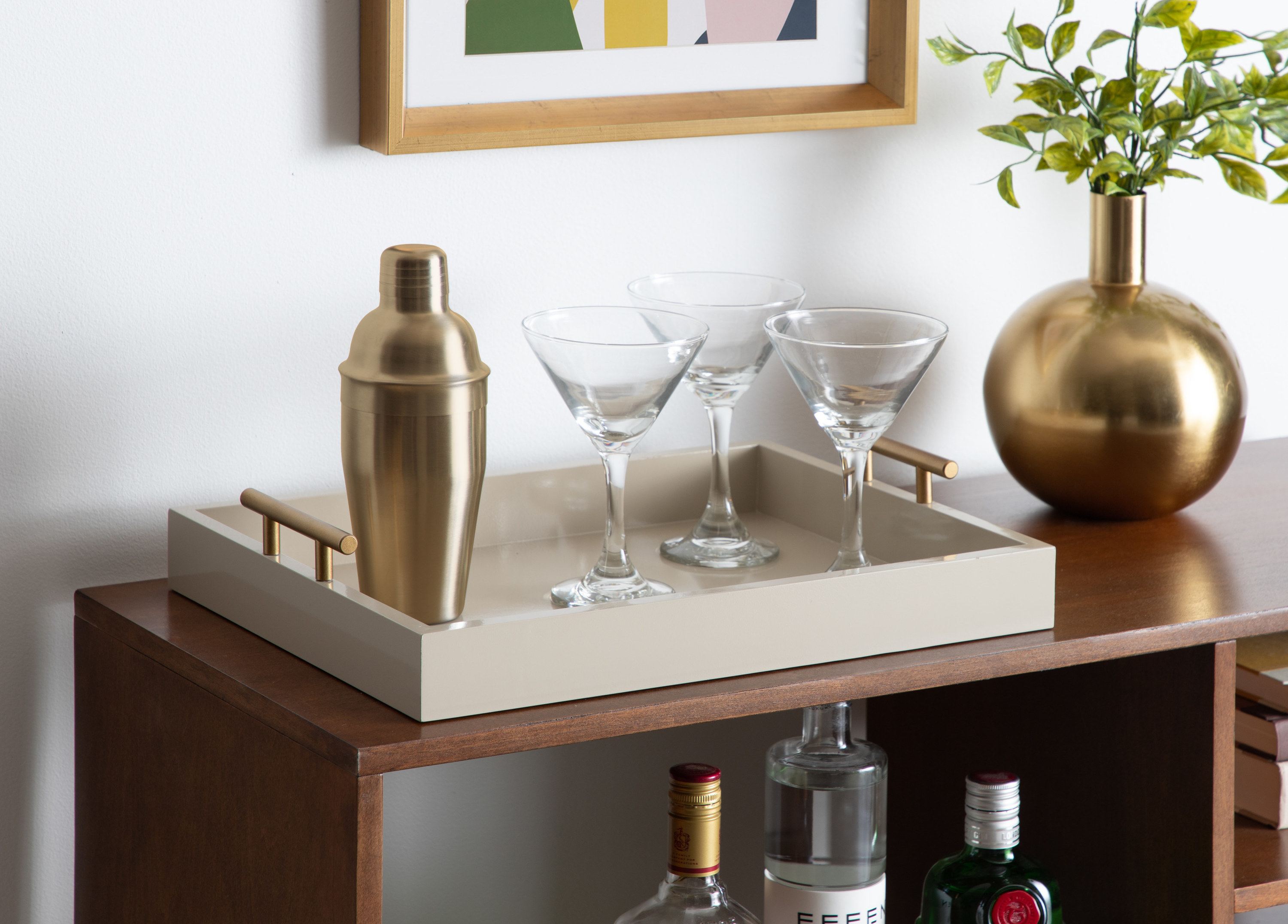 A white tray with gold handles